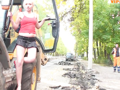 Girl does a strip show for a crew of road workers