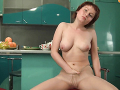 Babe playing with herself in kitchen