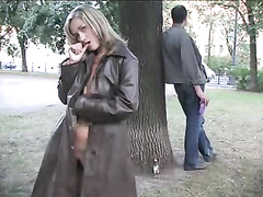 Petite blonde shows her yawning pussy in forest