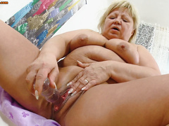 Plump grandma with dildo